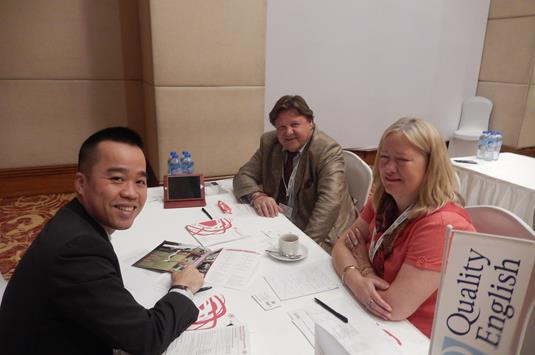 Sian and Petro Choma Peters of Absolutely English with Cuong Nguyen of Indec